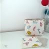 Panier motif origamis et lingettes assorties.